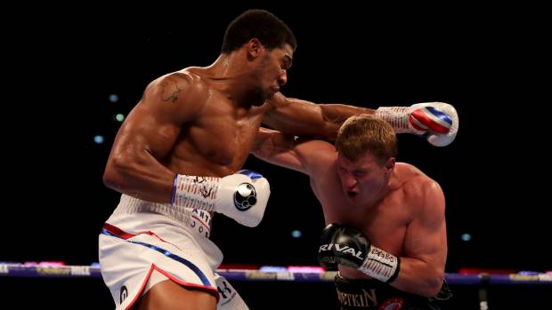 Anthony Joshua overcomes 'tough challenger' Alexander Povetkin