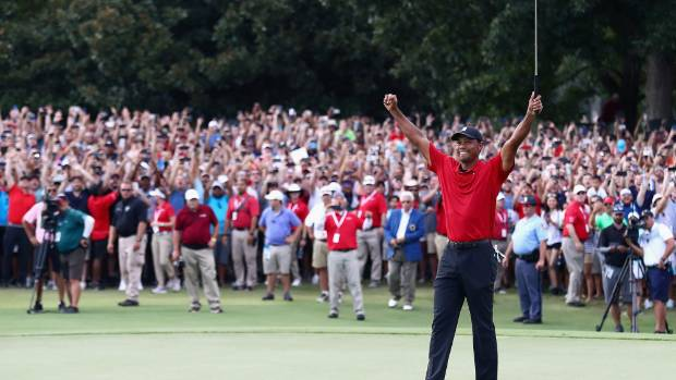 He's back! Tiger Woods a victor again for first time since 2013