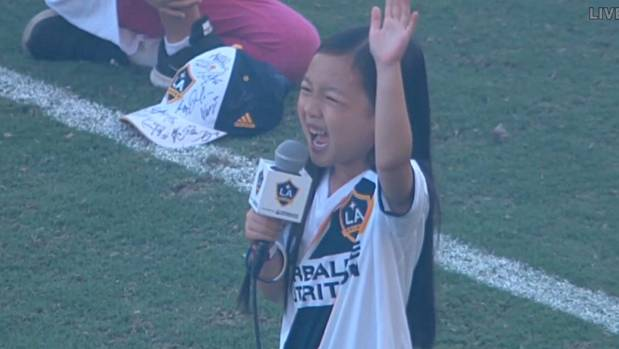 Malea Emma sings the US national anthem prior to LA Galaxy's MLS match against Seattle Sounders