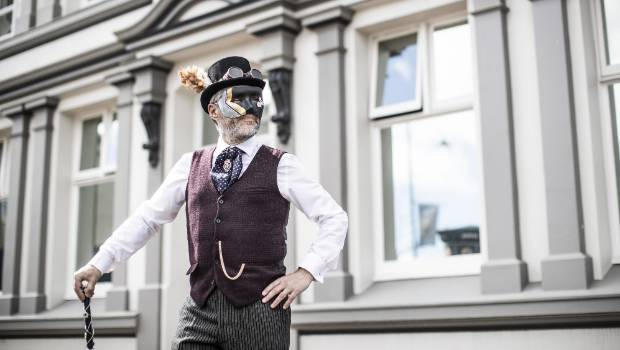 A Christmas Carol Steampunk Style cast member Nick Gastrell in the steampunk-style mask and clothing he intends to wear for the 2018 Masked Parade.