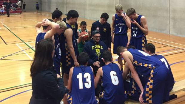 St John's Eagles coach Puke Lenden takes a time-out at 51-50 down with 20 seconds to go.
