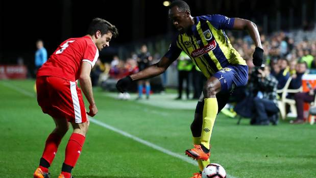 Usain Bolt controls the ball during the pre-season match between the Central Coast Mariners and Central Coast Football