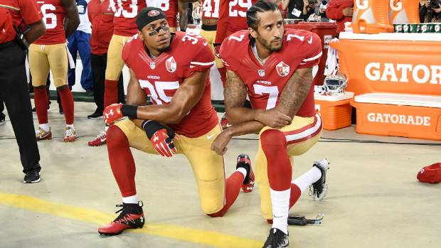Eric Reid left and Colin Kaepernick #7 kneel in protest during the national anthem while playing for the San Francisco 49ers