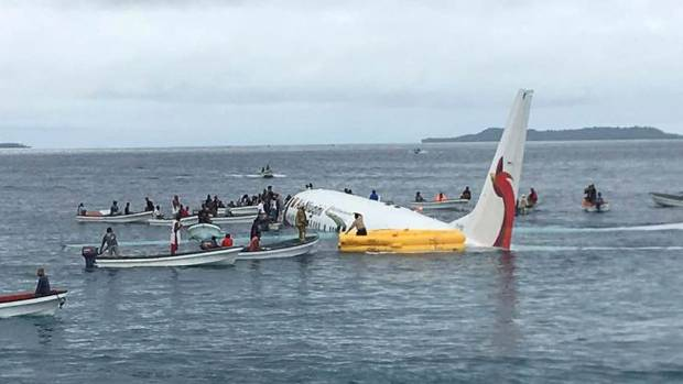 Airline now says 1 missing after Pacific lagoon plane crash