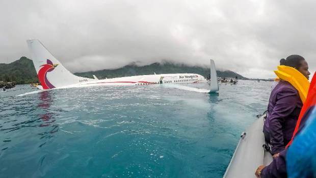 Locals in heroic rescue as plane overshoots runway into lagoon