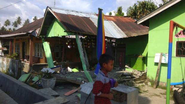 A house sits damaged after a magnitude 6.1 earthquake in Donggala central Sulawesi Indonesia