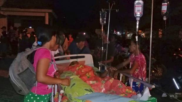 Patients are evacuated from a hospital following a strong earthquake in Poso central Sulawesi Indonesia