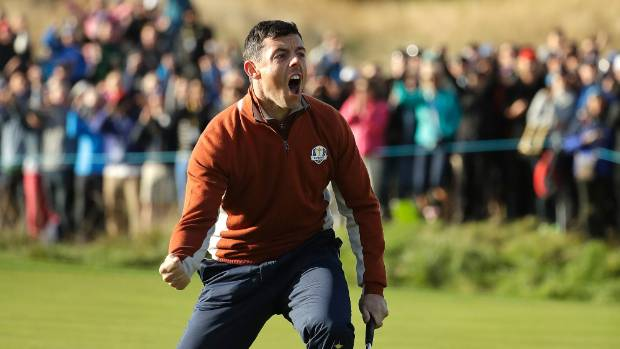 Europe's Rory Mc Ilroy celebrates after holing a putt to halve the 5th during a fourball match on the second day of the 42nd Ryder Cup