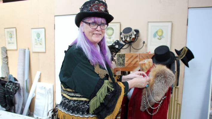 Steampunk Tinker workshop volunteer tutor Sue Clark gets to work on an outfit.