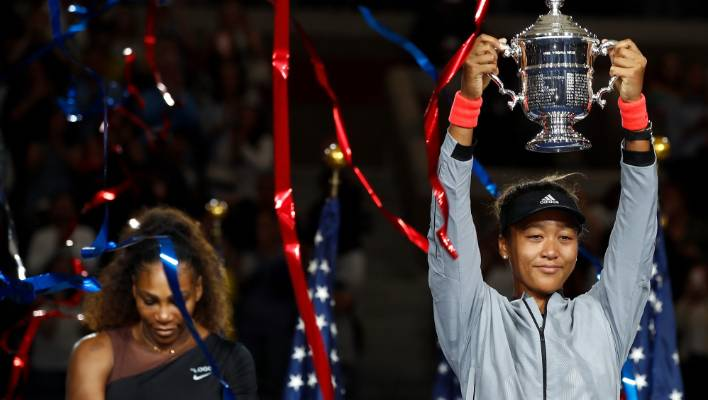 3eb89b6b3c303 Naomi Osaka of Japan poses with the US Open championship trophy after  winning the women s singles