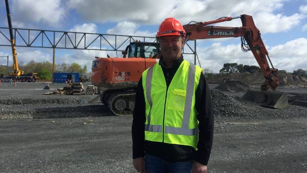 Ports of Auckland CEO  Tony Gibson in front of the construction of their first tenant at the Waikato Freight Hub.