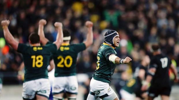 Cheslin Kolbe and his Springboks team-mates celebrate the upset over the All Blacks last month.