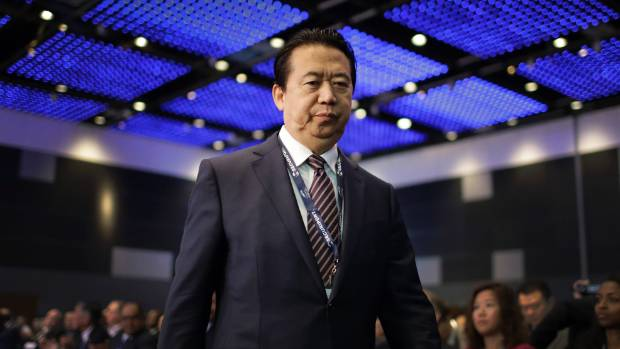 Missing Interpol president 'taken away' by Chinese officials for questioning