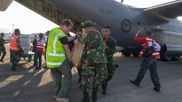 French rescuers search for bodies in debris of Indonesian quake disaster