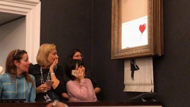 Banksy Painting Shreds Itself After Being Sold for $1.4 Million at Auction