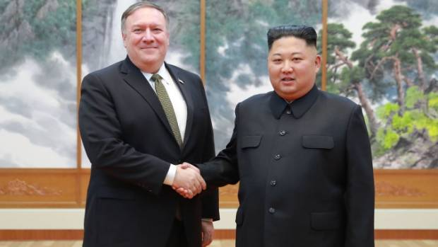 US Secretary of State Mike Pompeo shakes hands with North Korean leader Kim Jong Un in Pyongyang