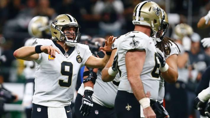 New Orleans Saints quarterback Drew Brees celebrates after he broke the NFL  all-time passing 34e1f8c81