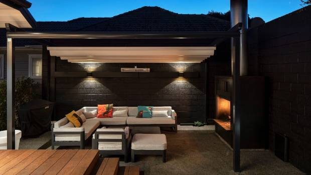 Architectural designer Richard Furze specified a fully automated retractable awning for his family's new outdoor living area.