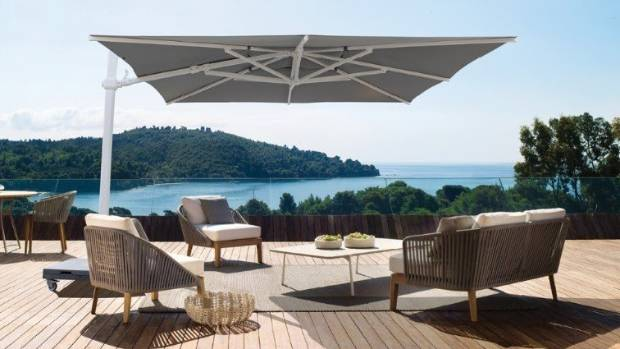 This mobile cantilevered sun umbrella from Dawson & Co makes it easy to follow the sun around.