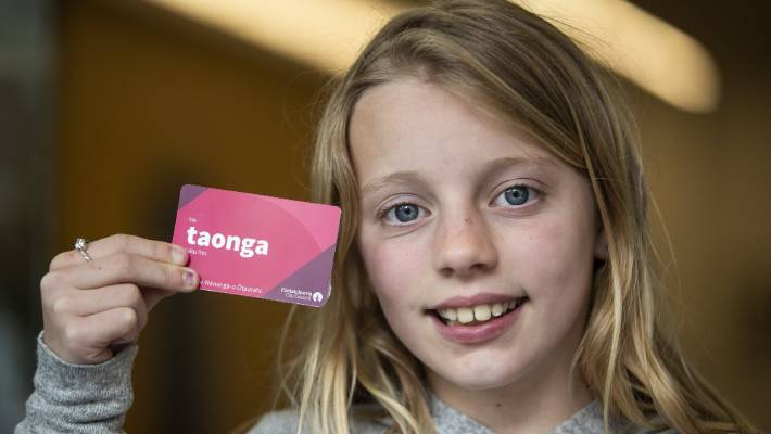 Eva, 9, got a new library card on the opening day of the new facility.