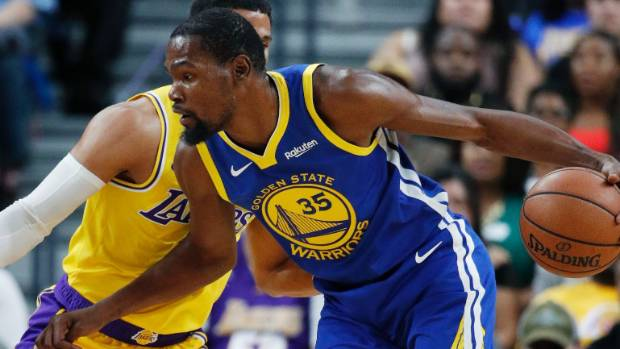 Curry, Durant lead Warriors past Thunder in festive opener
