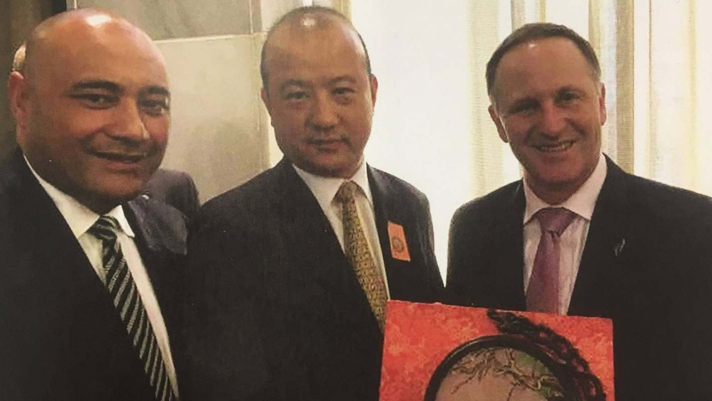 Yikun Zhang with former National MP Sam Lotu-Iiga and former Prime Minister John Key.