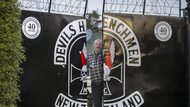 The Devils Henchmen are celebrating 40 years over Labour Weekend. Bryn Cox stands at the gates of the club's Washdyke headquarters.