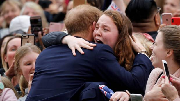 Britain's Harry scales Sydney Harbour Bridge, joins group hug at Bondi