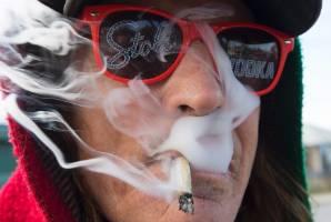 Bill Semeniuk, 67, smokes cannabis in Kamloops, British Columbia.