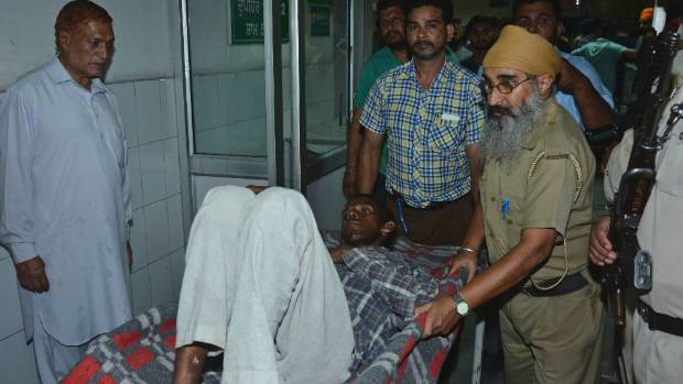 Protesters clash with police at Amritsar train accident site