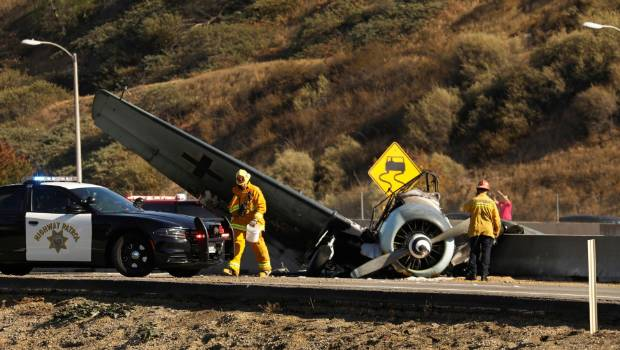 Vintage plane catches alight after crashing onto LA freeway