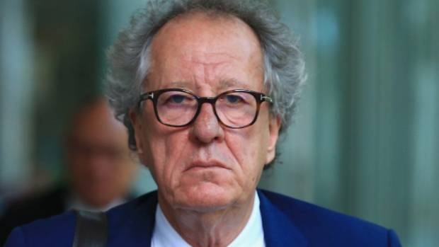 Actor Geoffrey Rush wipes tears in Court as he denies sex allegations