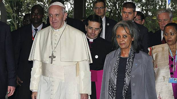Pope Francis walks next to then Director General of the United Nations Office at Nairobi Sahle Work Zewde in 2015