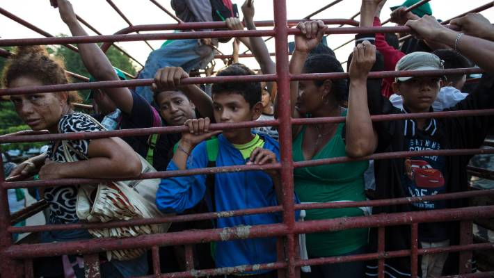 Thousands of caravan migrants seek asylum in Mexico