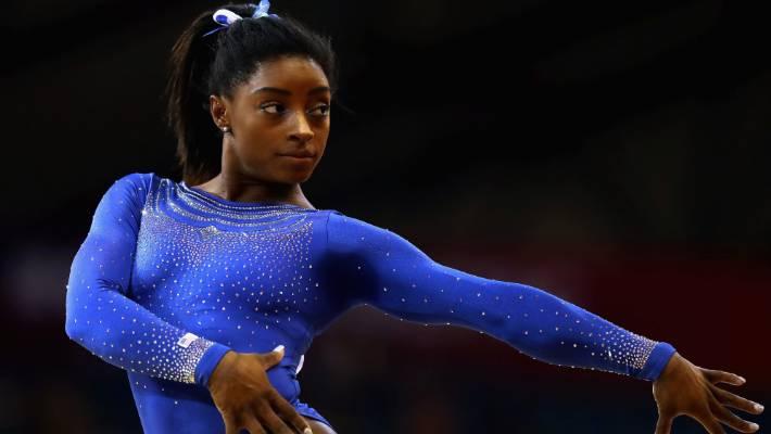 Simone Biles fights through kidney stone pain at gymnastics