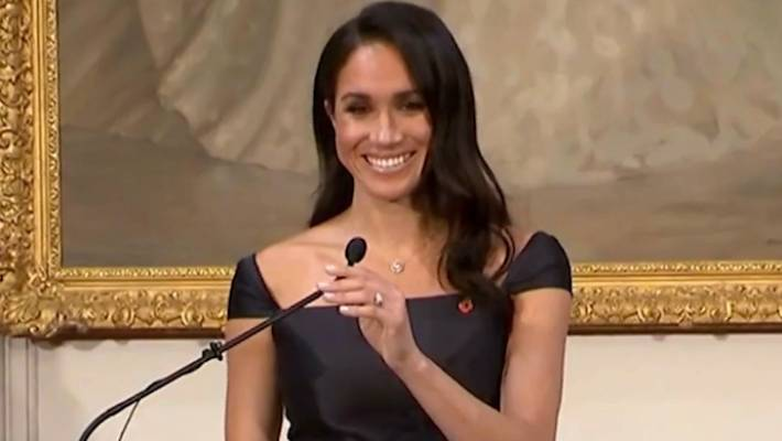 Adorable moment Harry lends Meghan his coat