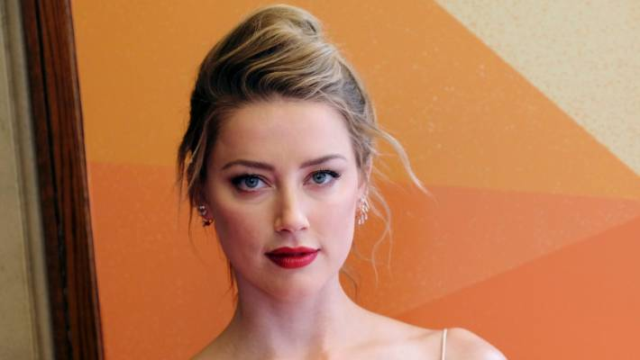 amber heard says she is happy to have moved on with her life stuff