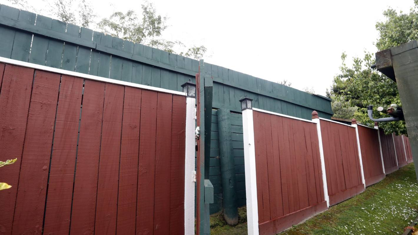 Neighbours can't get over problem fence dividing their