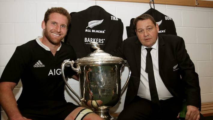 Kieran Read (left) and Steve Hansen celebrate with the Bledisloe Cup after an All Blacks win in 2013.