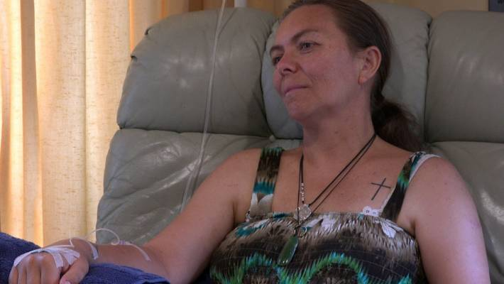 Tanya Filia receives vitamin C intravenously at a clinic in Whangarei.