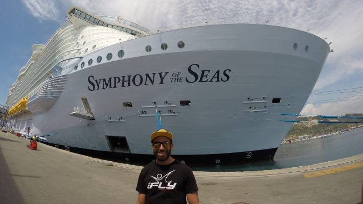 Byron Blane with his most recent floating home - the 223,081-tonne Symphony of the Seas.