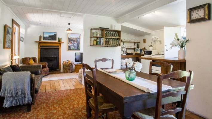 Owners Thomas Watt and Greer Garner have only added furniture and Taranaki art to the bach since they bought it in November 2017.