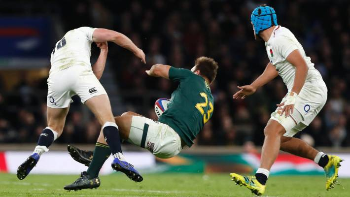 England's Owen Farrell knocks down South Africa's Andre Esterhuizen