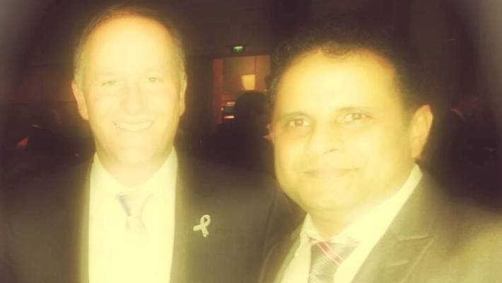 "Kharbanda with John Key - but his political connections say they are ""shocked"" by these accusations."