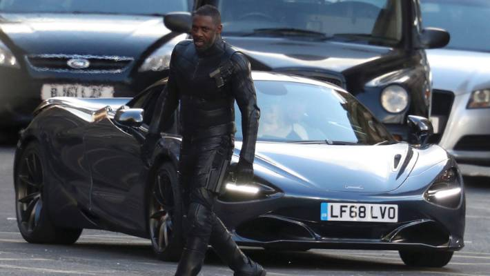 Elba walks near a Mclaren sports car while filming for the Fast and Furious movie franchise in Glasgow Scotland in October