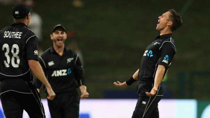 Trent Bolt of New Zealand celebrates his hat-trick with Kane Williamson and Tim Southee.