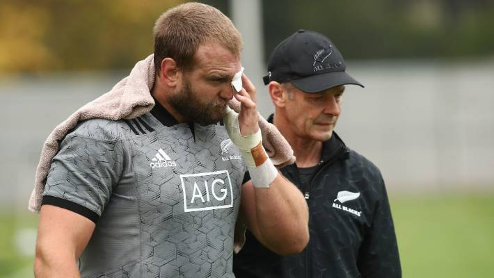 Joe Moody is assisted by Dr Tony Page after suffering a bad cut to his eye during training