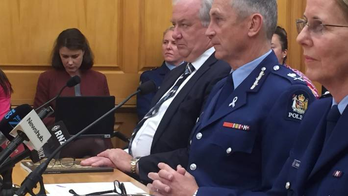 Police Commissioner Mike Bush, center, discussed questions about the appointment of Haumaha and subsequent investigations at the Parliamentary election committee meeting in Wellington