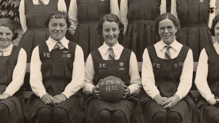 """Sylvia Peace Gilmour, holding a netball at her school in 1935. Born on November 12, 1918, the day the Armistice was announced in New Zealand, she chose to go by the name """"Peace"""" for the rest of her life."""