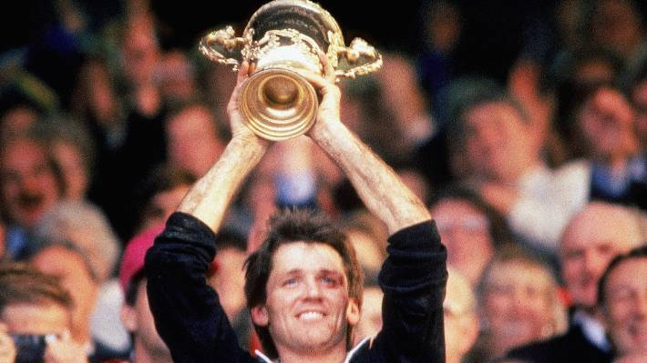 David Kirk lifts the Willam Webb Ellis Trophy after  the 1987 Rugby World Cup final.